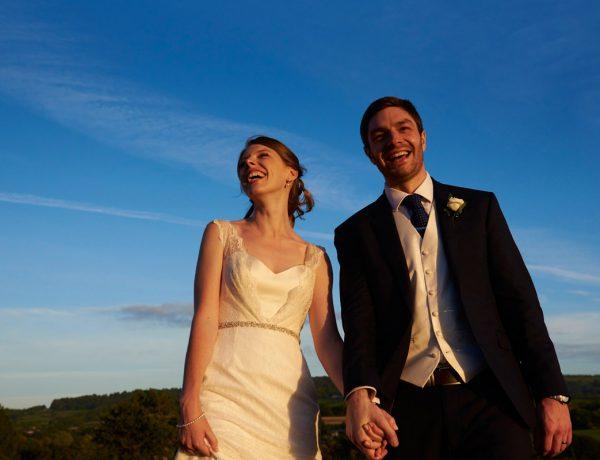 Bride and Groom enjoying beautiful evening light at Deer Park with blue skies