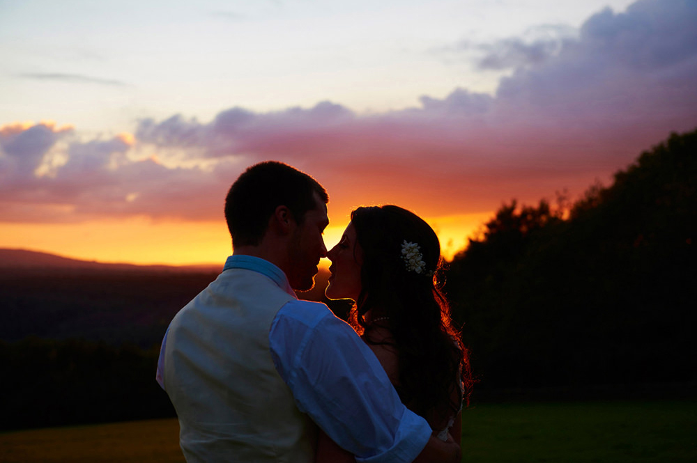 bride and groom with setting sun