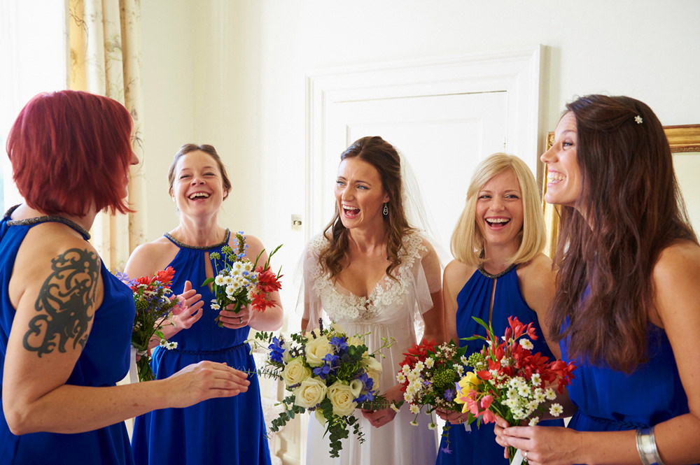 a natural moment between bride and bridesmaids