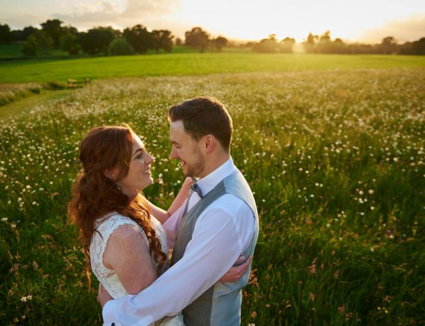 Bride and Groom with sunset at wedding at Rockbeare Manor in Exeter, Devon