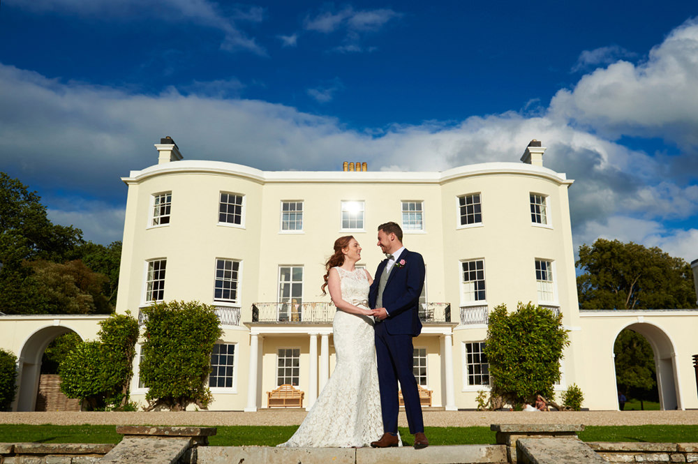 Bride and Groom infornt of Rockbeare Manor in Exeter Devon