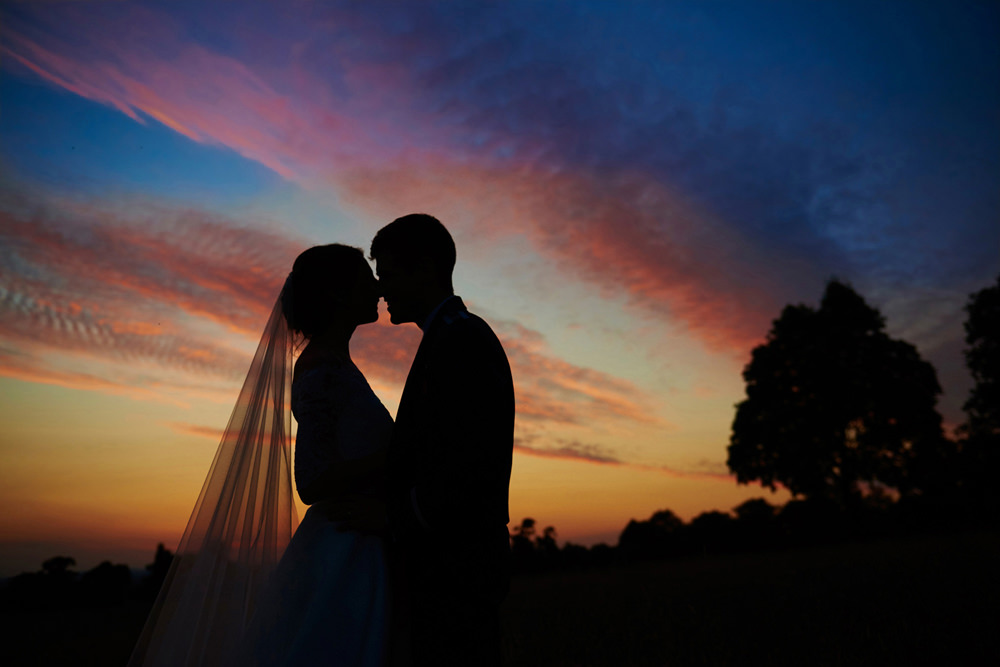 sunset shot of couple with lovely coloured sky