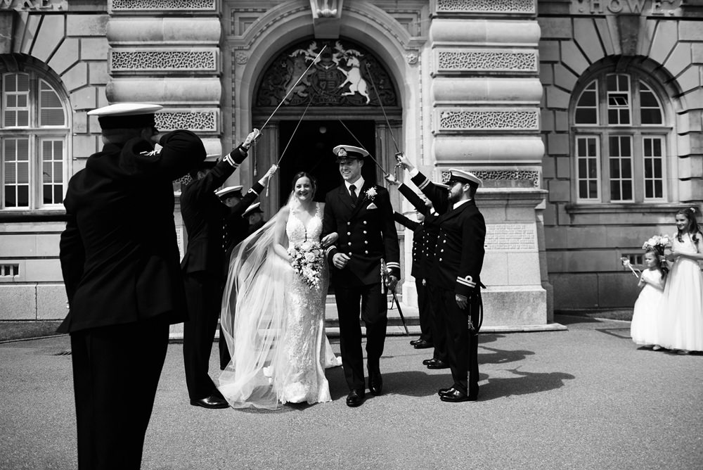 Dartmouth Navy wedding- bride and groom walking under sword arch