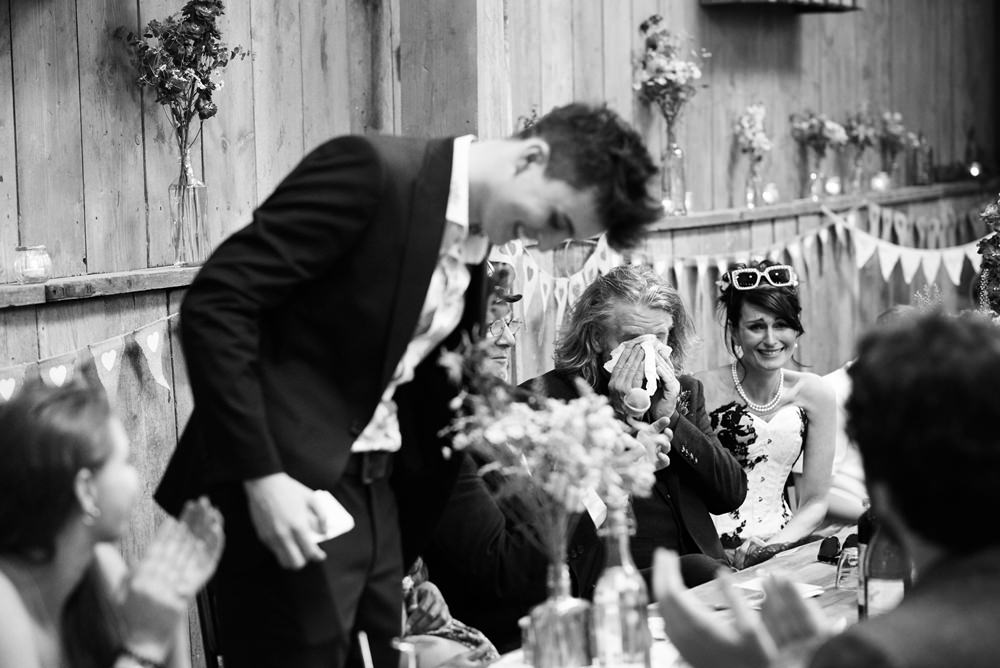 speeches and groom crying in black and white